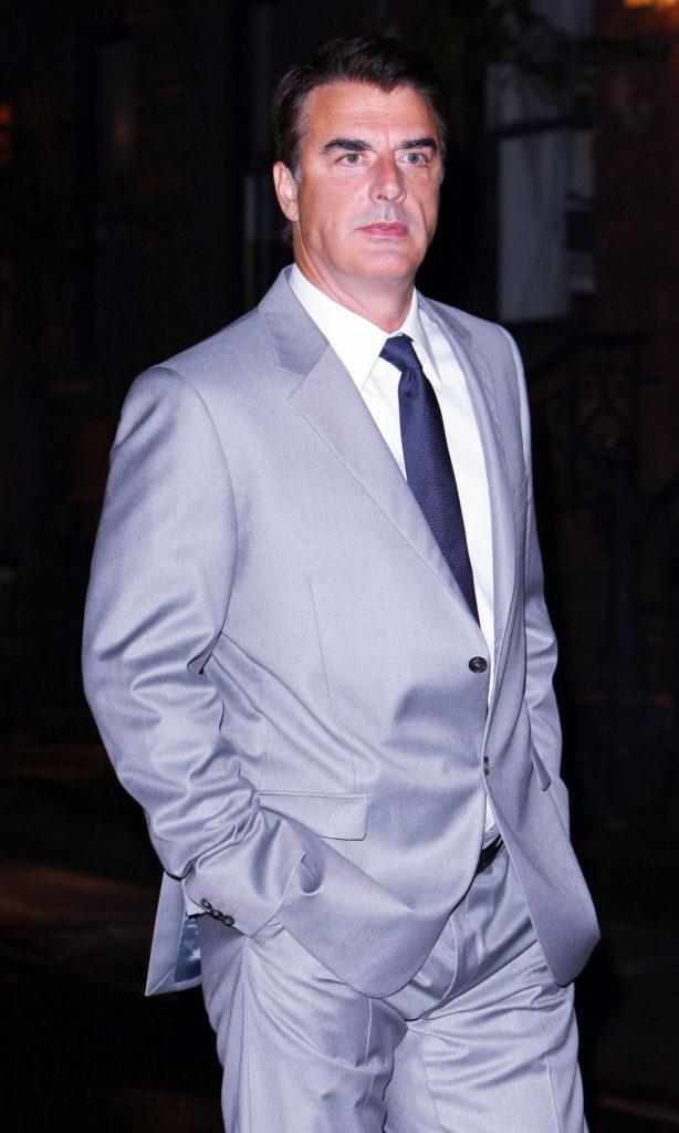 Actor Chris Noth aka Mr. Big, wearing a flashy silver suit, walks to the set of his latest movie