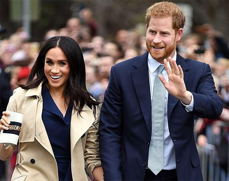 Meghan Markle z ciążowym brzuszkiem i książę Harry w Melbourne