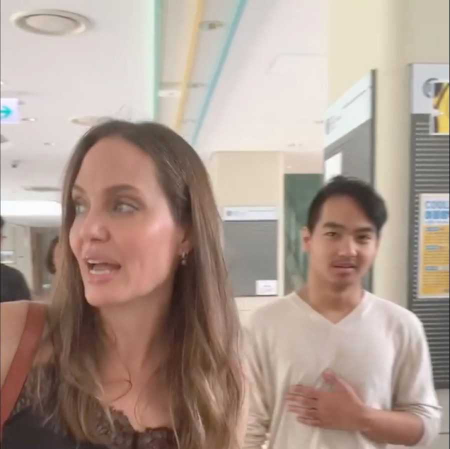 Actress and United Nations High Commissioner for Refugees (UNHCR) Special Envoy Angelina Jolie with her son Maddox are seen as she sends him off to university this still frame obtained from August 21, 2019 social media video in Songdo, South Korea
