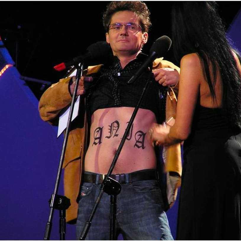 Kuba Wojewódzki - tatuaż