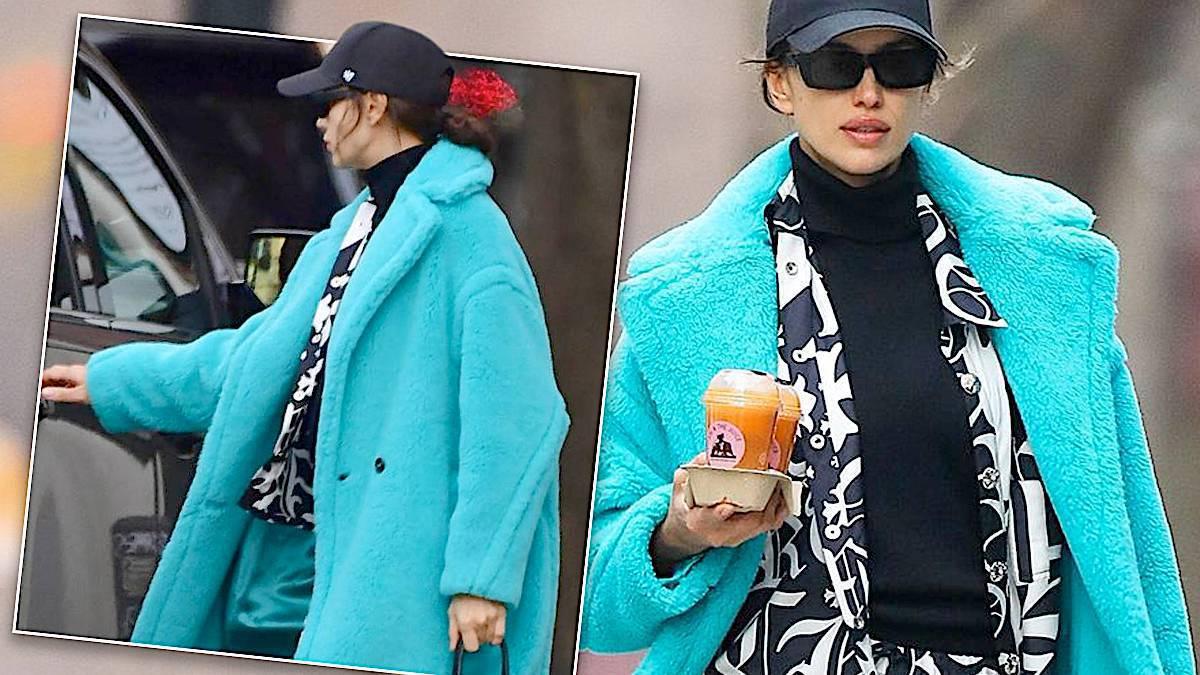 Irina Shyak w błękitnym płaszczu